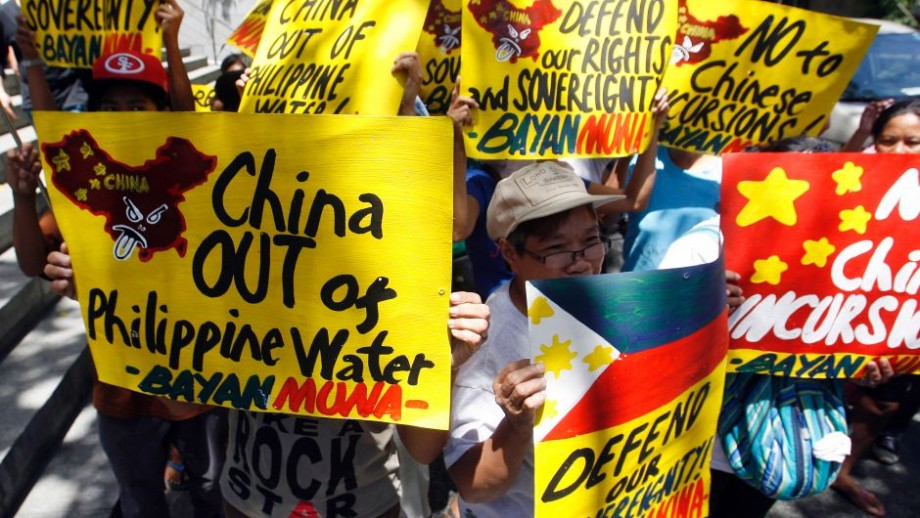 Filipino activists protest outside the Chinese Consulate. Photo: Cheryl Ravelo, Reuters