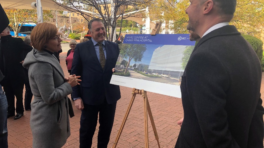 From left: ACT Health Minister Meegan Fitzharris, ANU Professor Russell Gruen and ACT Chief Minister Andrew Barr inspect plans for the new SPIRE Centre.