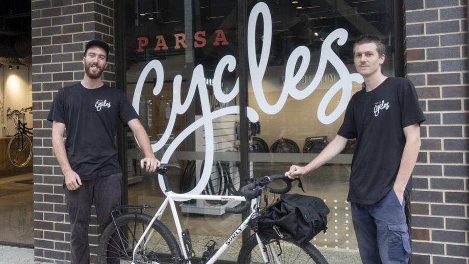Left to right: bike mechanic Kieran Mala and shop manager Zac Kotzur. Photo by Simon Jenkins, ANU.
