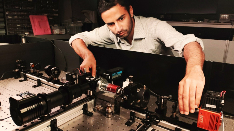 PhD student Aditya Tripathi working on optical diagnostics of the topological lasers. Credit: ANU