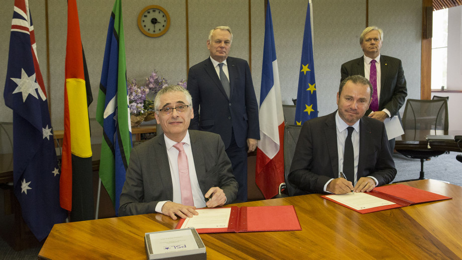 Professor Schmidt and French dignitaries signing the ANU-PSL agreement. Photo by Darren Boyd, ANU.