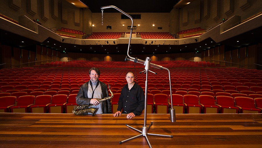 John Mackey and Stephen Holgate with the instrument stand in the foreground, at Llewellyn Hall. Photo: Stuart Hay, ANU.