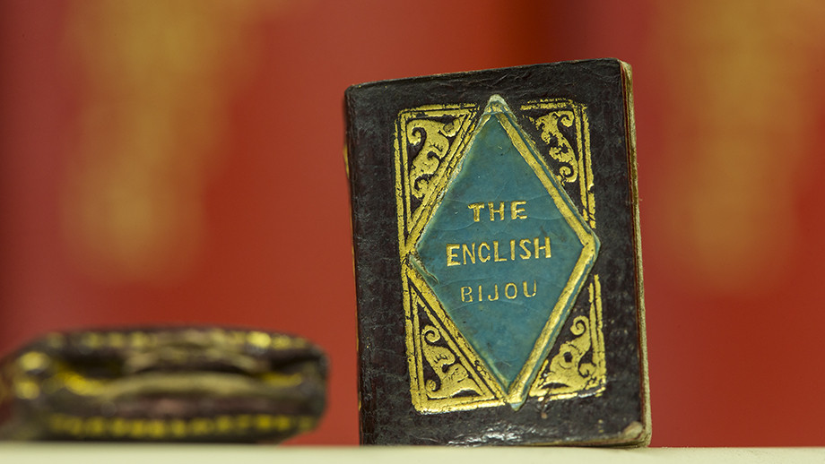 The smallest book in the ANU library collection, the English bijou almanac for 1839, is just 20 millimetres high by 14 millimetres wide. It also comes with its own box cover (to the left of the picture) where it is stored. Photo by Stuart Hay, ANU.