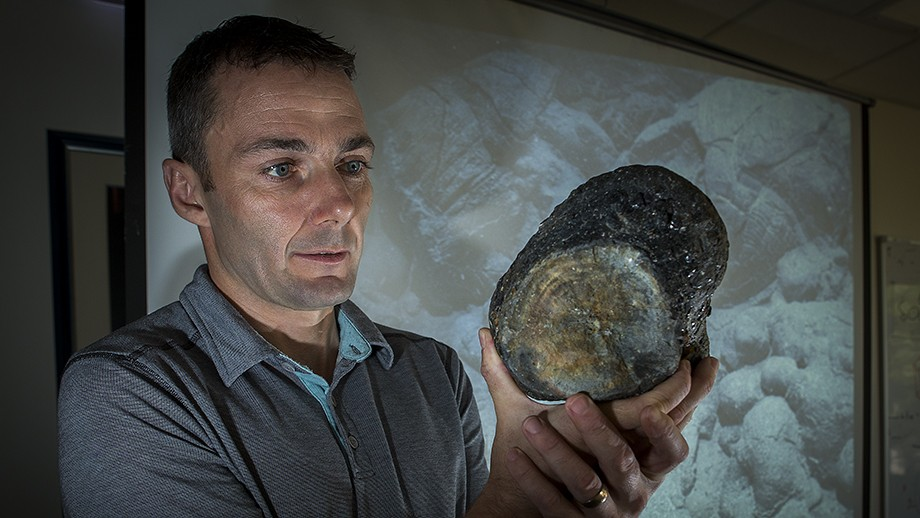 Dr Mark Kendrick with a sample of volcanic glass