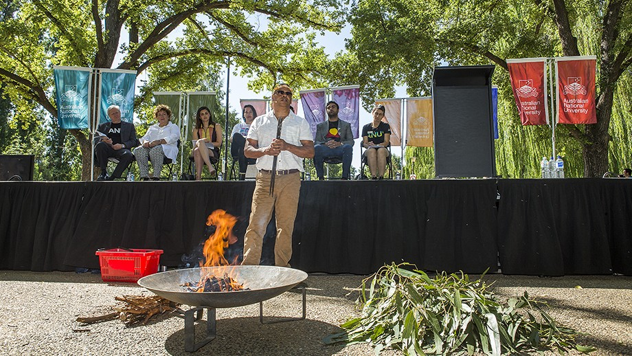 Billy T. Tompkins conducts a traditional Indigenous smoking ceremony to welcome students and staff and open the 2017 Commencement Address. Photo by Stuart Hay, ANU.