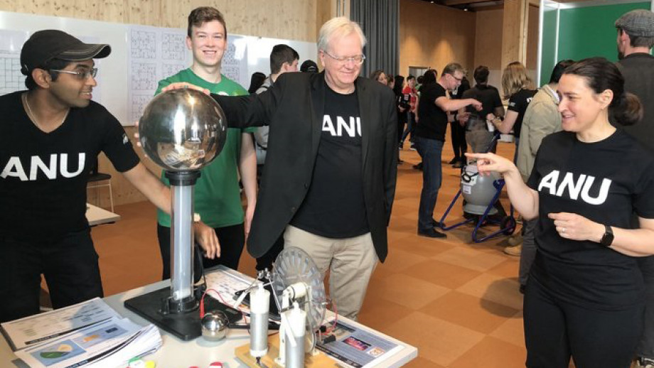 Vice-Chancellor standing with hand on plasma ball