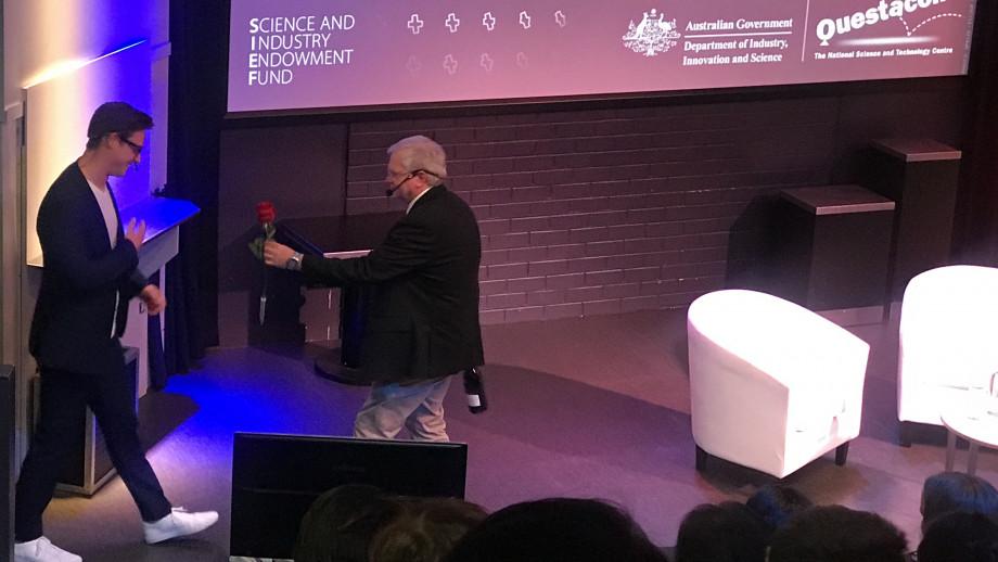 Vice-Chancellor hands Matt Agnew a rose