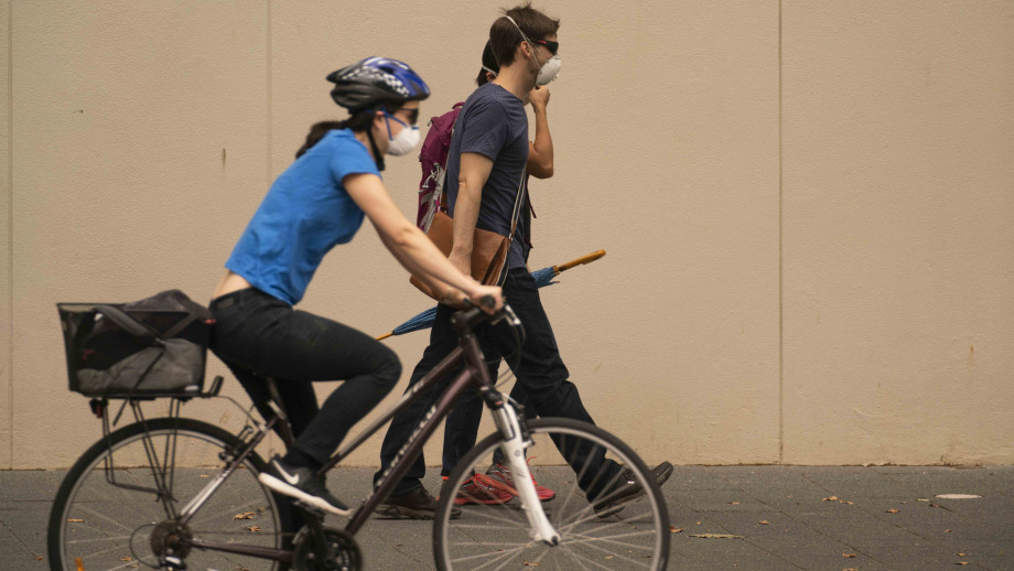 Commuters wear masks on their way to work in January 2020.