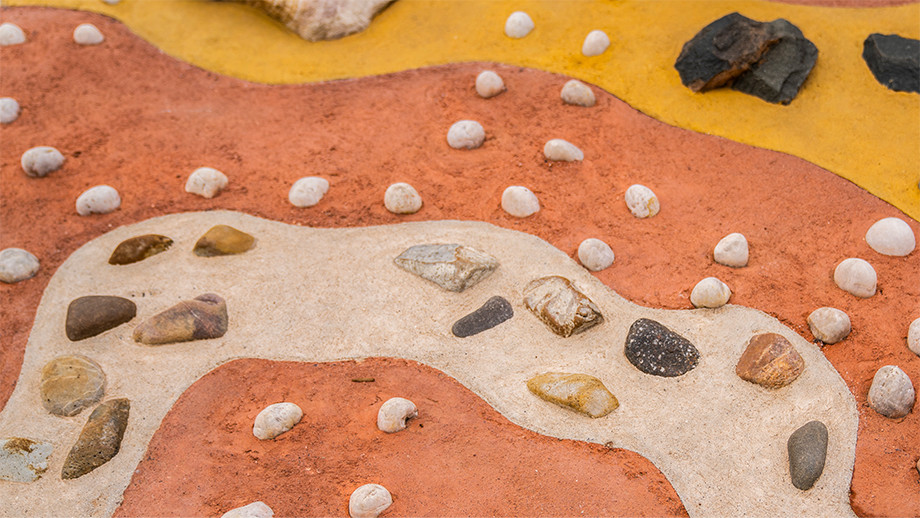 The Ground Map was designed in collaboration with clan elders and Wellspring Environmental Arts and Design. The Map includes stones from Mt Ainslie, Black Mountain and Red Hill and several artefacts from the elders' collections.
