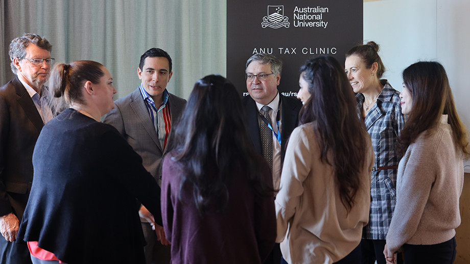 ATO officials with students who will staff the tax clinics
