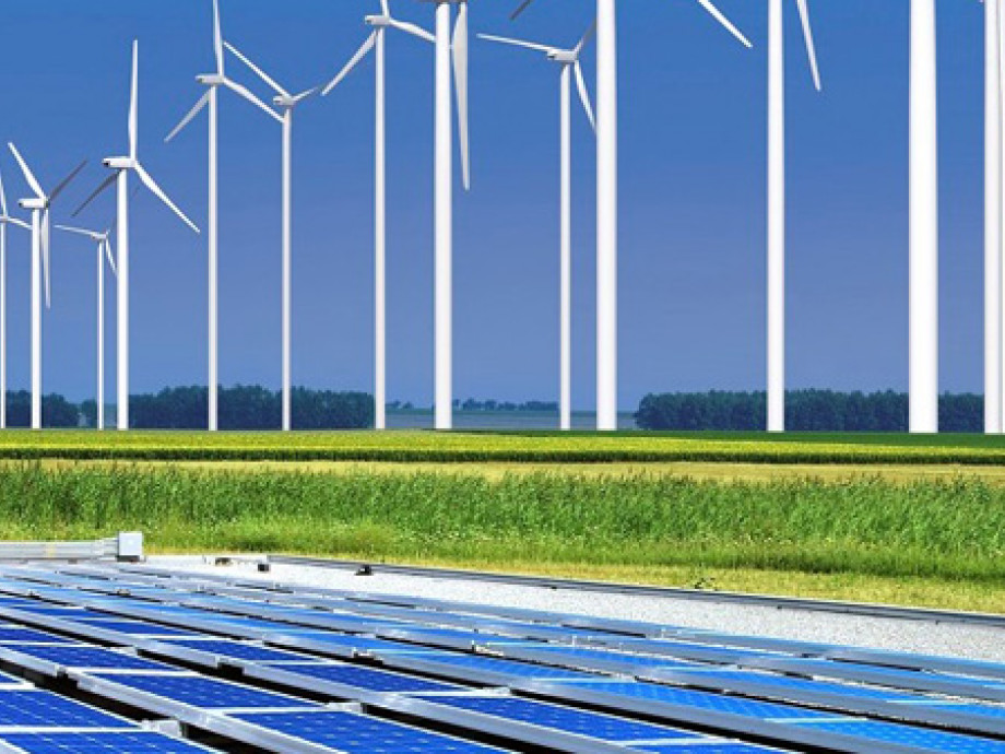 Image shows a wind farm and solar panels.